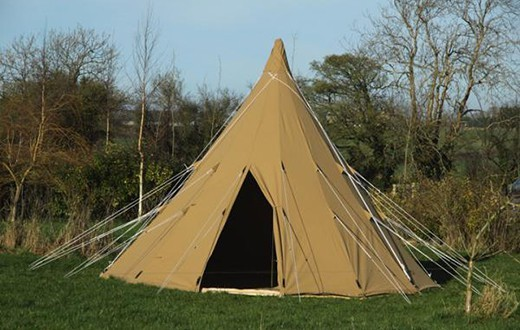 accommodation - Hearthworks Tipi Tent at Bestival