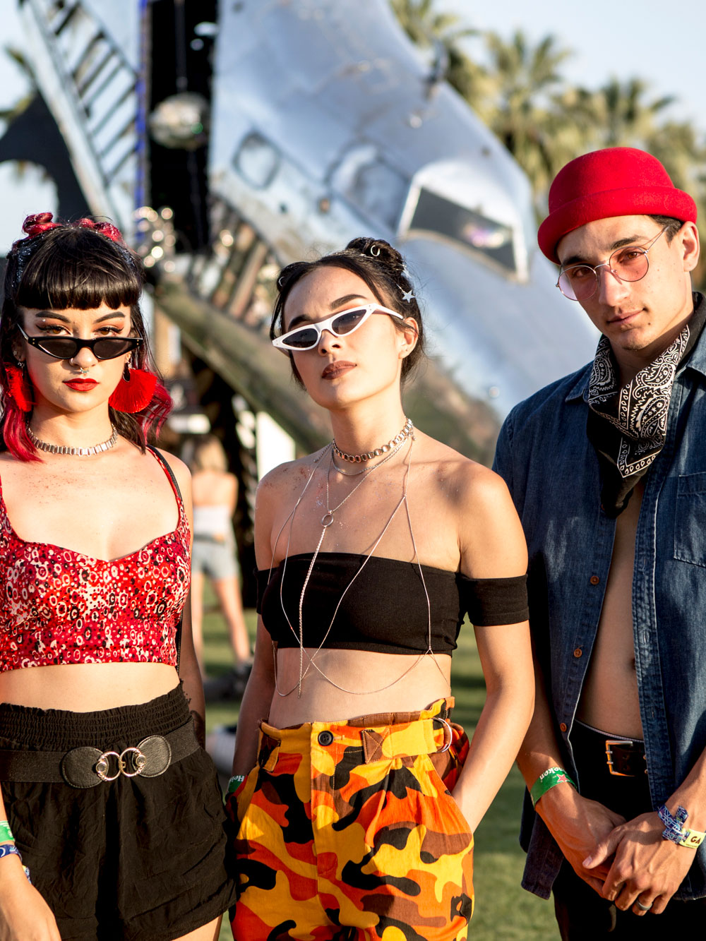 d11c503b041d Paisley bandana  crop top  yellow camo  slick shades  chokers – this shot  has it all. Coachella 2018